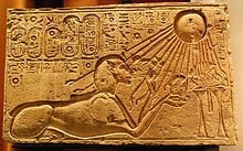 Akhenaten in the guise of the Sphinx worships Aten in the form of the sun-disc